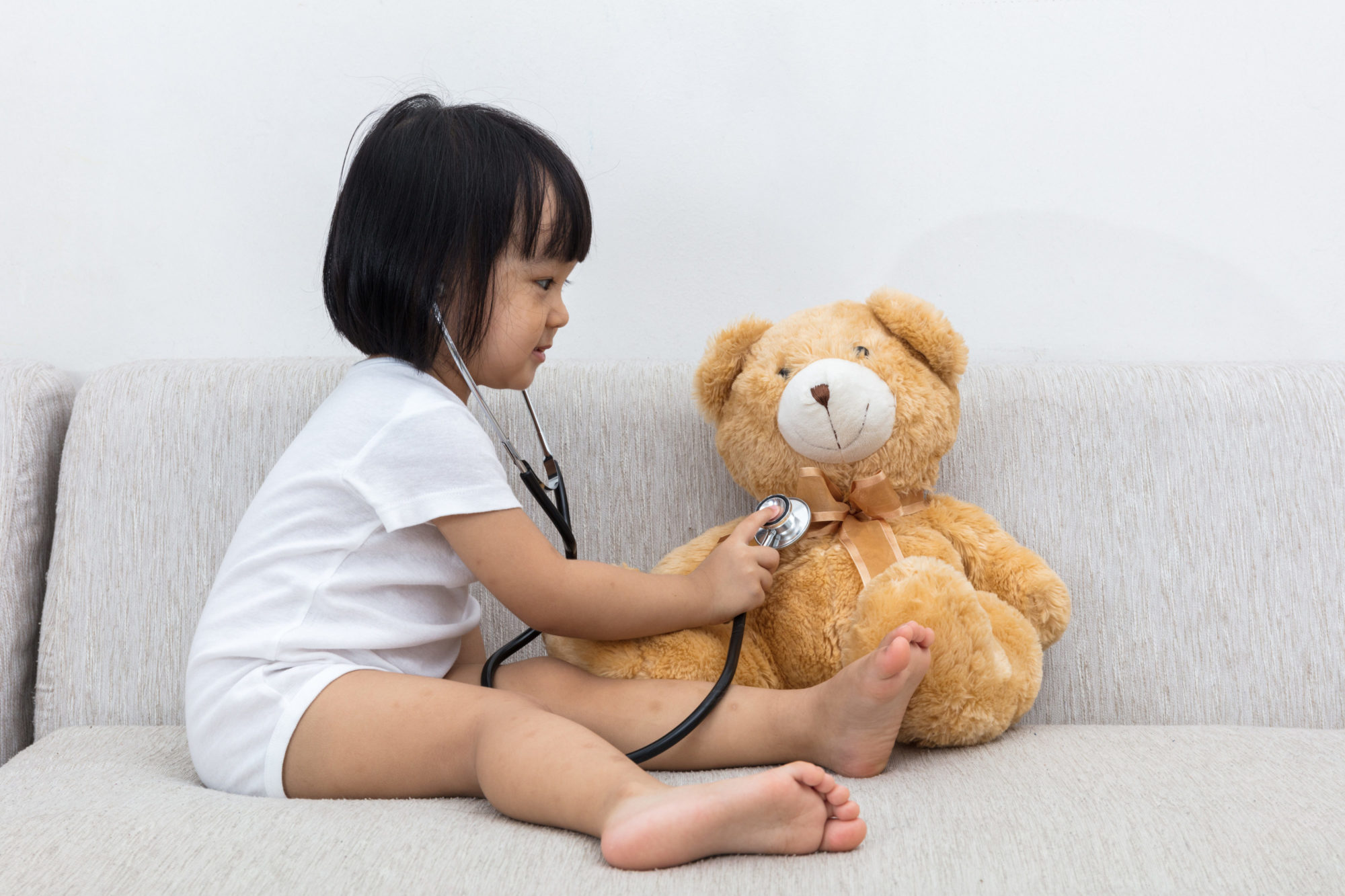 Child checking on Teddy Bear